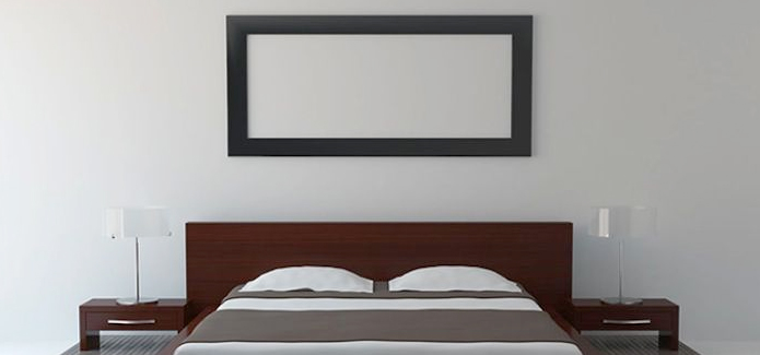 A white infrared panel heater in the bedroom